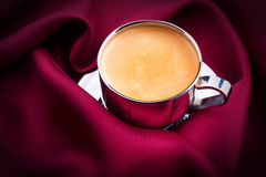 Cup of Coffee with red silk Royalty Free Stock Images