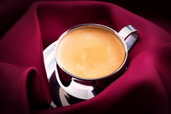 Cup of Coffee with red silk Royalty Free Stock Photography