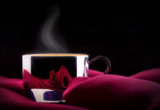 Cup of Coffee with red silk Stock Image
