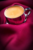 Cup of Coffee with red silk Stock Photos