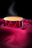 Cup of Coffee with red silk Royalty Free Stock Image