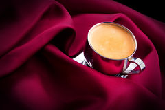 Cup of Coffee with red silk Stock Images
