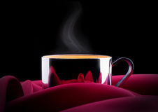 Cup of Coffee with red silk Royalty Free Stock Photos
