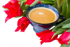 Cup of coffee with red tulips Stock Photos