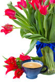 Cup of coffee with red tulips Royalty Free Stock Photos