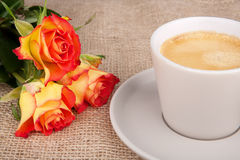 Cup of coffee red-yellow roses. Cup of coffee  and tree red-yellow roses Royalty Free Stock Images