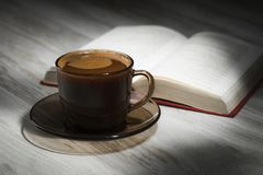 Cup of the coffee relating to the book Royalty Free Stock Photography