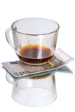 Cup with coffee residues and euro Royalty Free Stock Photography