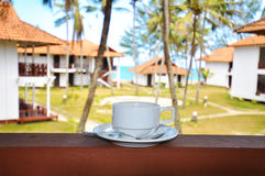 Cup of coffee at the resort facing sea Stock Photo