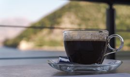 A cup of coffee in a restaurant stock image