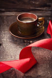 Cup of coffee and  ribbon Stock Image
