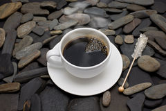 Cup of coffee with rising steam and reed sugar.  Stock Photo