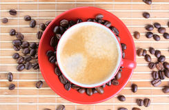 Cup of coffee with roasted beans Royalty Free Stock Photos
