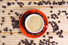 Cup of coffee with roasted beans Stock Photos