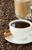Cup of coffee and roasted beans Royalty Free Stock Photos