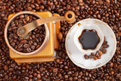 Cup of coffee and roasted beans Stock Photography