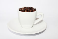 A cup of coffee. With roasted coffee beans on white background stock photography