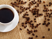 Cup of coffee and roasted coffee beans. Stock Image