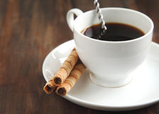 Cup of coffee  with rolled wafers Royalty Free Stock Image