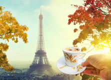 Cup of coffee in Paris, France with view of Eiffel tower Royalty Free Stock Photo