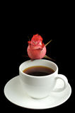 Cup of coffee and a rose Stock Image