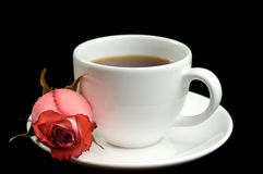 Cup of coffee and a rose Stock Photos