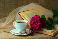 A cup of coffee and rose Stock Image