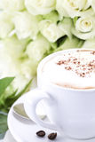 Cup of coffee and roses royalty free stock photo