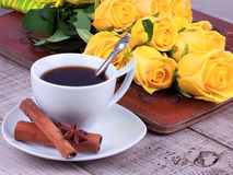 Cup of coffee and roses Royalty Free Stock Image