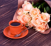 Cup of coffee and roses Stock Images