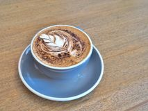 A cup of coffee with Rosetta pattern Royalty Free Stock Photography
