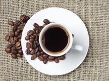 Cup of coffee on a rough fabric Royalty Free Stock Photos
