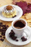 Cup of coffee and round cake Stock Image