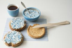 Rusk with blue aniseed balls, muisjes, Dutch treat for when a baby boy is born in The Netherlands stock photography