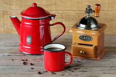 Cup of coffee with rustic coffee pot Royalty Free Stock Photography