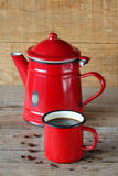Cup of coffee with rustic coffee pot. Cup of coffee with rustic red coffee pot Royalty Free Stock Photos