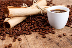 Cup of coffee with rustic paper rolls Royalty Free Stock Images