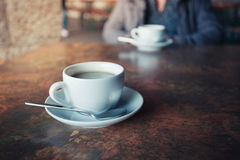 Cup of coffee on rustic table Royalty Free Stock Photo