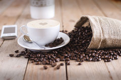Cup of Coffee Beside Sack of Coffee Beans Stock Photos