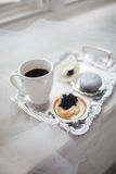 A cup of coffee a sandwich of black caviar on a silver tray. Breakfast millionaire stock image