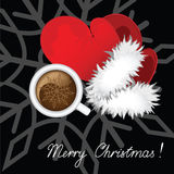 Cup of coffee for Santa. Cup of coffee and mitten Santa against the black background Stock Image