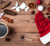 Cup of coffee and Santas hat, Christmas set, gift and Christmas tree. Celebration Stock Image
