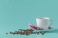 A cup of coffee on a saucer on a aquamarine background Stock Photography
