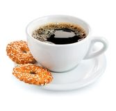 Cup of coffee on saucer with biscuits Stock Images