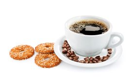 Cup of coffee on saucer with biscuits Royalty Free Stock Photos