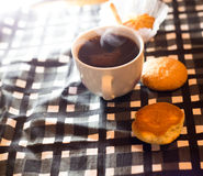 Cup of coffee. On saucer with biscuits Stock Images