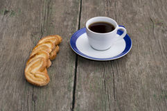 Cup of coffee on a saucer with a blue border and cookies in a ro. W, a subject drinks Stock Photo