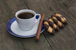 Cup of coffee on a saucer with a blue border and cookies Royalty Free Stock Images