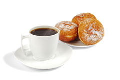 A cup of coffee and saucer with donuts Stock Image