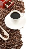 Cup of coffee with saucer and mill background Royalty Free Stock Image